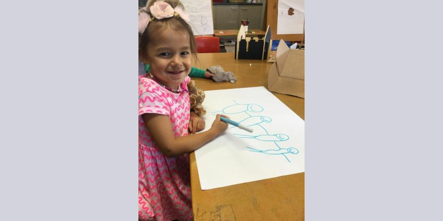 Girl drawing at kindergarten