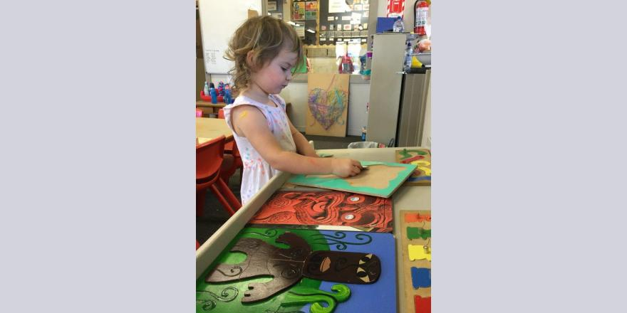 Girl playing at kindergarten