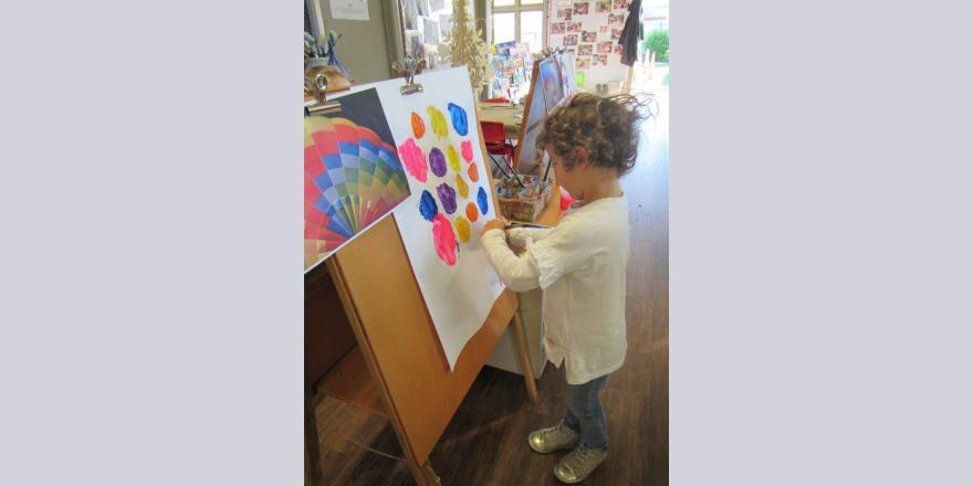 Girl painting at kindergarten