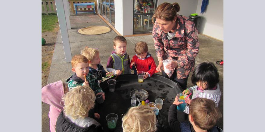 Making colourful drinks at preschool