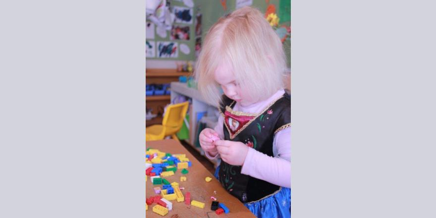 Girl playing with Lego at Annabel's Avonhead preschool.