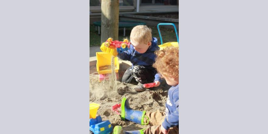 Two kids playing in the sandpit at Annabel's Avonhead preschool