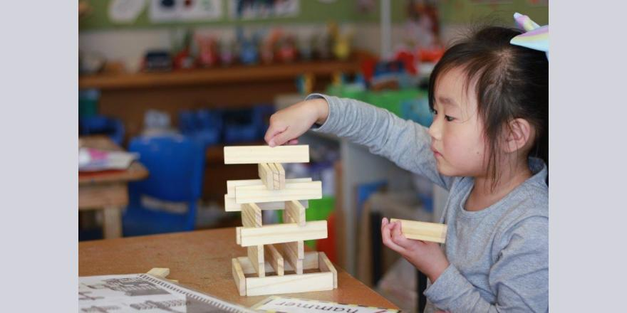 Girl building at Avonhead preschool