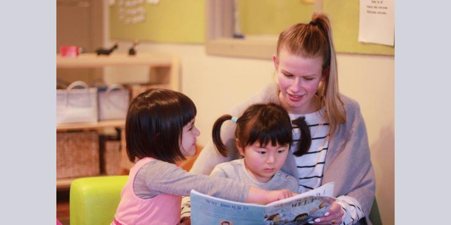 Teacher reading to kids at Avonhead preschool