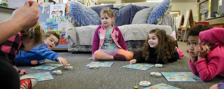Children playing educational board games at our Christchurch preschool