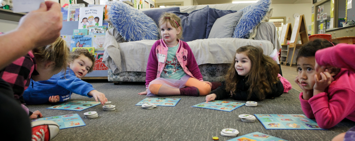 Children playing educational board games at our preschool