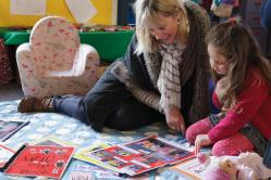 Teacher and child reading at preschool in Christchurch